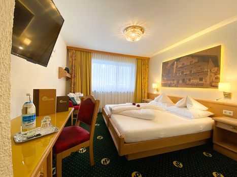 Die komfortablen Zimmer im Hotel Pachmair sorgen für einen gemütlichen Aufenthalt.